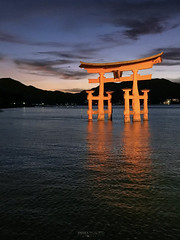 Itsukushima Floating Torii - Miyajima Island (Japan) (Andrea Moscato) Tags: andreamoscato giappone japan asia japanese 日本 nihon nippon asian light luce shadow ombre prefecture attraction ombra site national nature natura natural naturale landscape paesaggio sky cielo view vivid vista scenic blue park history historic ancient treasure wood art architecture monument brilliant water silhouette sea seascape torii gate bay hiroshima unesco world heritage island isola seto inland setonaikai riflesso reflection tide orange mountain hill nuvole clouds deep evening blu wave sunset dusk dark