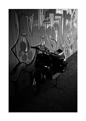 City Classic (Thomas Listl) Tags: thomaslistl blackandwhite biancoenegro noiretblanc monochrome light mood dark bike vespa motorbike graffiti wall urban city 35mm underpass tunnel subway