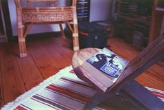 Currently reading. (35mm) | Exp. 09/2001 Perutz SC 100. (samuel.musungayi) Tags: film 35mm 24x36 135 negative negativo négatif scan expired color colour couleur candid yashica t5 samuel musungayi samuelmusungayi photographie photography fotografia light life analog argentique perutz sc 100