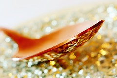 Copper spoon on silver plate (kerwitcherwoo) Tags: macromondays copper stilllife spoon