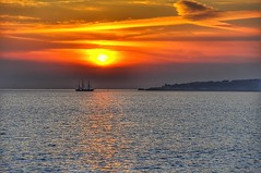 Sunset (mvtal aka Alan Chris) Tags: ocean water sea sky sun sunset boat coast dslr copyright