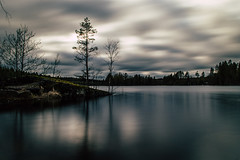 Lakescape IV (mabuli90) Tags: finland lake water clouds tree forest woods long exposure dark night rock cliff sky waterscape