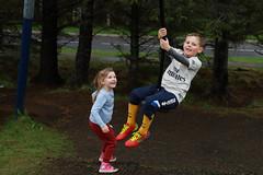 Alex playing in the monkey swing (erlingurt) Tags: siblings canon eos rp swing kids