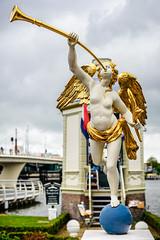 Angel and Trumpet (Brett of Binnshire) Tags: historicalsite zaandam netherlands statue locationrecorded art architecture clouds bridge weather museum zaanseschans northholland ball blue gold wings