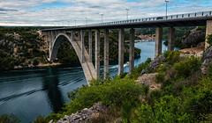 The Bridge (free3yourmind) Tags: bridge river arch boat crossing passing croatia floating
