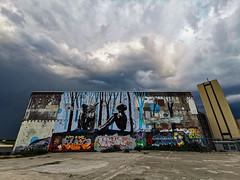 Graffiti and a dramatic sky (Sjaco Manuputty) Tags: graffiti clouds sky dramatic honigcomplex architecture architectural building factory urban nijmegen netherlands art graffitiart wideangle huaweip30pro
