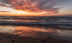 Thinking of a Place (Aaron Springer) Tags: michigan northernmichigan lakemichigan thegreatlakes lakeshore shoreline surf beach wave stone cloud twilight outdoor nature waterscape