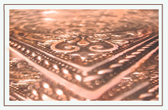 Motifs on Metal - MM - Theme-Copper (LOVE.OVER.LUST.) Tags: mm macromondays copper metal shinning carvings embosed etching engraving patterns design bokeh selectivefocus backlit sundaylights