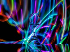 Colour Craze (Karen_Chappell) Tags: colour color colors colours colourful multicoloured led light lights black glow lightpainting longexposure stilllife glass refraction orb sphere ball round circle blue pink green purple orange psychedelic rainbow spectrum reflection red yellow