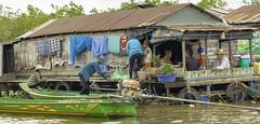 Tonle Sap Lake Family #2 (oldbourbonguy) Tags: cambodia siemreap siemreapprovince tonlesaplake family floatingvillage