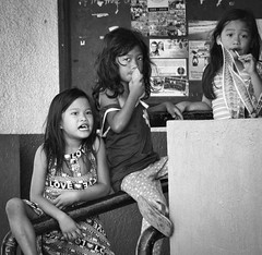 Girls (Beegee49) Tags: street people children eating lollipop blackandwhite monochrome bw happyplanet sony a6000 bacolod city philippines asia asiafavorites