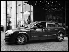Cruisin' (NickD71) Tags: fuji fujifilm xt1 mirrorless csc fujinon xf1855 snapseed monochrome mono street candid compact daily life people greenwich peninsula car cruising window hanging out underground park