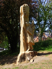 Sun nymph (Nekoglyph) Tags: whitby yorkshire sculpture wood trees green chainsaw carved nymph girl solstice steveiredale pannettpark grass sun day shadows bird leaves publicart trunk