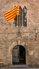 Barcelona building (S.R.Murphy) Tags: april2019 barcelona architecture building oldbuilding historicalbuilding heritage catalonia spain urban urbanlandscape flag door colour texture brick travel travelphotography gothicquarter