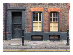 Former Huguenot Settlement, East London, England. (Joseph O'Malley64) Tags: spitalfieldslifecom spitalfields huguenots huguenot huguenotsettlement huguenotheritage persecuted exiled french protestant weavers lacemakers thebuiltenvironment newtopography newtopographics manmadeenvironment manmadestructure building structure georgian georgianhouse georgianbuilding eastlondon eastend london england uk britain british greatbritain doorway doorsurround stucco stuccowork mouldings woodwork woodenpanelleddoor doorfurniture entrance exit windows sashwindows internalwindowshutters shutters drainpipe brickwork bricksmortar cement pointing render doorstep basements ironwork barredwindows bollards cannonbollards coalhole coalholecover limestonepavement accesscover granitekerbing tarmac doubleyellowlines noparkingatanytime parkingrestrictions waterdamage frostdamage airpollutiondamage acidraindamage colouredbricks architecture architecturalfeatures architecturalphotography britishdocumentaryphotography accuracyprecision