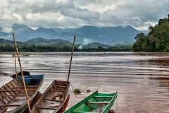 Nam Khan River (Trouvaille Blue) Tags: southeastasia laos river boats haze mist clouds trees bamboo trouvailleblue