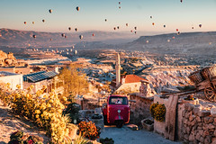 Balloons over Uchisar town in Cappadocia. (liseykina) Tags: cappadocia turkey balloon air hot landscape travel valley rock nature anatolia kapadokya tourism hill ancient geology goreme nevsehir mountain spectacular flight formation unesco capadocia fairy sandstone sunrise adventure balloons town street house cave morning cappadociaturkeyballoonairhotlandscapetravelvalleyrocknatureanatoliakapadokyatourismhillancientgeologygoremenevsehirmountainspectacularflightformationunescocapadociafairysandstonesunriseadventureball original big stock