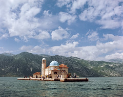 Church of Our Lady of the Rocks (bruscwillis) Tags: 65mm film kodak vision3 50d medium format pentax 645n fuji xpress c41 motion picture stock kotor bay montenegro water sea mountains church landscape clouds sky