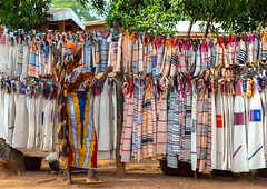 Senufo textiles and clothing at street market, Savanes district, Waraniene, Ivory Coast (Eric Lafforgue) Tags: adults adultsonly africa africanculture africanethnicity artandcraft businessfinanceandindustry colourimage côtedivoire cotton craft cultures decoration design fashion hanging horizontal indigenousculture ivorycoast ivory4283 korhogo linen market marketretailspace marketstall oneadultonly oneperson onewomanonly pattern photography retail senoufo senufo streetmarket textile textileindustry textured trading tradition village waraniéné westafrica women waraniene savanesdistrict