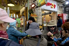 Trying EtroGat (oxfordblues84) Tags: machaneyehudamarket oat overseasadventuretravel jerusalemisrael jerusalem israel walkingtour market hotshot michele man women woman traveler people person juicebar revi margo juices freshfruitjuices