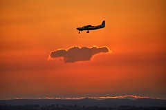 Flying high in the sky. (Ian Ramsay Photographics) Tags: camden newsouthwales australia aircraft airport stunning sunset backdrop yellow cloud sky