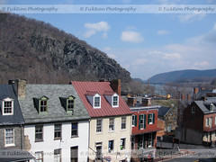 Out Over Harpers Ferry (ficktionphotography) Tags: westvirginia virginia maryland harpersferry explore town buildings potomacriver shenandoahriver river bridge mountain rock forest trees