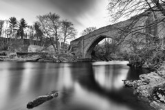 "fine art, long exposure, black and white shot of the ancient and charming Brig o'Balgownie over the River Don, Old Aberdeen, Aberdeen, Scotland (grumpybaldprof) Tags: bw blackwhite ""blackwhite"" ""blackandwhite"" noireetblanc monochrome ""fineart"" striking artistic interpretation impressionist stylistic style contrast shadow bright dark black white illuminated mood moody atmosphere atmospheric calm peaceful tranquil restful ""longexposure"" ""neutraldensity"" nd aberdeen ""aberdeencity"" ""granitecity"" ""oldaberdeen"" grampian scotland uk ""beautifulcity"" ""northeastscotland"" aberdeenshire ""brigobalgownie"" ""originalbridgeofdon"" ""13thcentury"" ""riverdon"" 1320 ""robertthebruce"" ""bishophenrycheyne"" ""richardcementarius"" granite sandstone arch bridge water river ""kingdomofscotland"" ""warofindependence"" canon 7d ""canon7d"" sigma 1020 1020mm f456 ""sigma1020mmf456dchsm"" ""wideangle"" ultrawide"