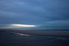 Blue (ulbespaans) Tags: blue sky drama dramatic mood moody moodynature moodysky lessismore lessismoreoutdoors sea beach coastline shore sand reflection wave