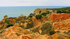 Castles in the Sand (well, earth, but...) (elena.voroniouk) Tags: travel cliffs beach sea nature landscape formations outside algarve portugal