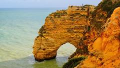 One Leg in the Sea (elena.voroniouk) Tags: travel cliffs beach sea nature formations outside algarve portugal