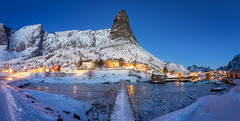 Merlin's Hat (Hilton Chen) Tags: lofoten moskenes norway reine bluehour cabins fishing footbridge houses ice mountain river rock snow spire village winter panorama