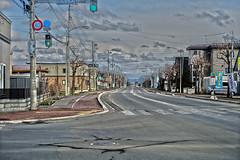 To the East, variant (sjrankin) Tags: 15april2019 edited road view yuni intersection trafficsignal crosswalk clouds hills kitahiroshima hokkaido japan