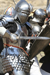 knight attacks (Daniel0556) Tags: knight suit armor medieval battle helmet war conflict history fighting sword metal weapon protection men shield human people body renaissance past traditional warrior ancient chivalry festival glove iron courage heavy power old strength background aggression armed crusades steel security knightly forces protective person violence military historic army hand historical sun
