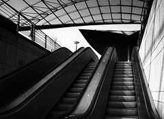 Upwards (frankdorgathen) Tags: mundane city urban wideangle weitwinkel alpha6000 sony1018mm monochrome blackandwhite schwarzweis schwarzweiss haltestelle bahnhof station ruhrpott ruhrgebiet dortmund westfalenhalle escalator rolltreppe