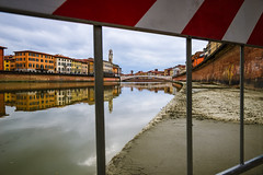 Pisa in-grata (Laura Sergiampietri) Tags: landscape urban pisa pise bridge pontedimezzo arno river riverbank lungarno bricks red wall water old town tower clock clocktower torredellorologio colours reflection buildings cloudy winter fence mud bars muddy smcpentaxda1770mmf4alifsdm smcpda1770mmf4alifsdm italy tuscany toscana