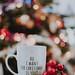 white and black text ceramic mug beside candy cane - Credit to https://myfriendscoffee.com/