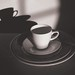 grayscale photography of mug with spoon on top of saucer and plate - Credit to https://myfriendscoffee.com/