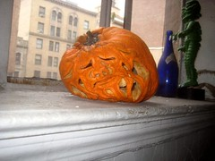 Pruneface from Dick Tracy 2008 Halloween Pumpkin 9916 (Brechtbug) Tags: second pruneface villain jack o lantern carved 2008 its various stages decay nyc window sill new york city holiday orange rotting gourd newspaper news paper cartoon comics sunday funnies strip prune face african art bird mexican skeleton
