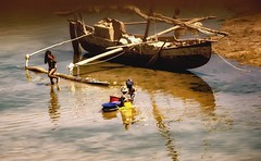 River Life (Rod Waddington) Tags: africa afrique afrika madagascar malagasy river boat pirogue washing water people women