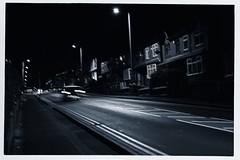 Street (Bill Eiffert) Tags: street road houses row night toned streetlights lamps cars headlights straight lines