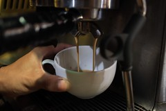 person pouring brown liquid on white teacup - Credit to https://myfriendscoffee.com/ (John Beans) Tags: coffee cafe coffeebeans shopbeans espresso coffeecup cup drink cappucino latte