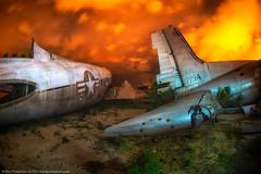 Aftermath (dejavue.us) Tags: aircraft nikon desert airplane vle boneyard orange tucson longexposure nightphotography fuselage fullmoon arizona nikkor calamity clouds d800 fisheye