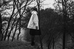 Black trees, white cloak (vlkvaph) Tags: nature lake forest model girl young female atmospheric atmosphere melancholic melancholy sad mood helios 50mmlens 50mm monochrome cinematography cinematic canon6d bw blackandwhite blackwhite cloak