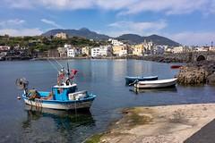 Ischia Ponte (2benny) Tags: blue blu italy italia borgo town clouds nuvole fishing pesca boat barca cielo sky bridge ponte sea mare ischia ischiaponte