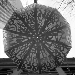 untitled (kaumpphoto) Tags: rolleiflex 120 tlr ilford bw black white city urban street word letter lamp lantern minneapolis round segment star design graphicdesign sphere