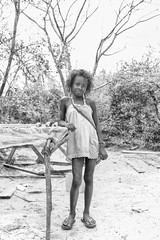 She Sells Sea Shells (Rod Waddington) Tags: africa afrique afrika north madagascar malagasy blackandwhite mono monochrome girl sea shells outdoor streetphotography street trees landscape table culture cultural child
