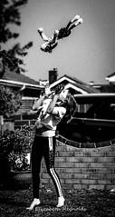 Day 109. (lizzieisdizzy) Tags: blackandwhite blackwhite black monochrome mono monotone monochromatic chromatic chroma energy energetic child playing catch throw female girl jump toy doggie garden sunny happy