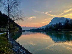 Sunrise over Kaiser mountains by the river Inn near Kufstein, Tyrol, Austria (UweBKK (α 77 on )) Tags: österreich kaiser mountains alps alpen kaisergebirge tyrol tirol austria europe europa iphone kufstein sunrise sun morning river inn water flow stream reflection sky tree