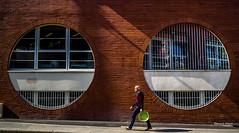 Street - Circles (François Escriva) Tags: street streetphotography paris france people candid olympus omd photo rue colors sidewalk man sun circles green orange red bricks wall building walking geometry fun funny