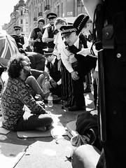 Taking Notes (Sean Batten) Tags: london england unitedkingdom europe streetphotography street blackandwhite bw people police policeman candid protest protester city urban oxfordcircus climatechange extinctionrebellion fuji x100f fujifilm